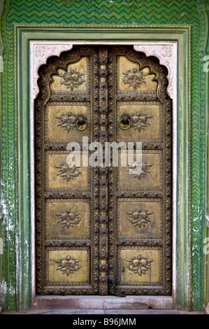 A bronze, gold door in a green doorway, or archway, in the courtyard of the City Palace in the Pink City - Stock Photo