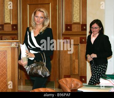 Russian Health and Social Development Minister Tatiana Golikova and Economic Development and Trade Minister Elvira - Stock Photo