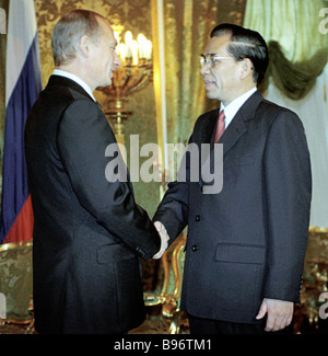 Russia's President Vladimir Putin meeting in the Kremlin with Nong Dyk Man, general secretary of the Communist Party - Stock Photo