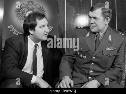 Dmitry Rogozin left chairman of the Congress of Russian Communities and Lieutenant General Alexander Lebed right - Stock Photo
