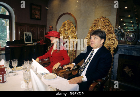 Russian presidential candidate Vladimir Bryntsalov and his wife Natalya at table after voting - Stock Photo