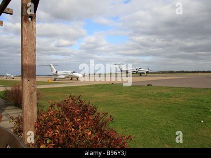 Three  executive aircraft on the apron at Biggin Hill Airport - Stock Photo