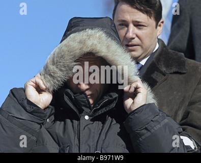 Russian President Vladimir Putin accompanied by Krasnoyarsk Territory Governor Alexander Khloponin right visits - Stock Photo