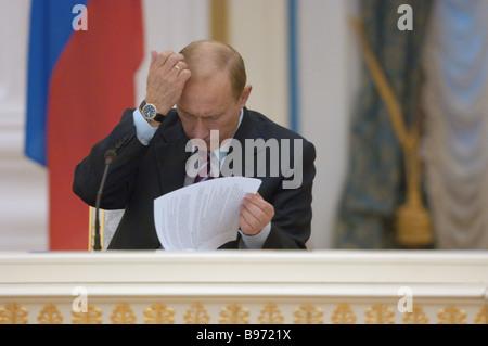 Russian President Vladimir Putin addresses spokesmen of the Russian Industrialists and Entrepreneurs Union RSPP - Stock Photo