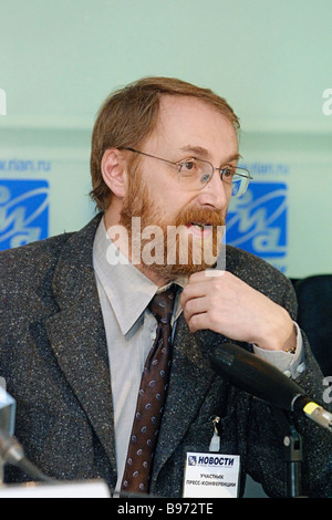 Alexander Oslon President of the Public Opinion Foundation attends RIA Novosti news conference that discussed Russians - Stock Photo