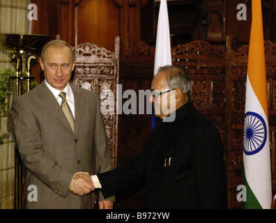 President Vladimir Putin of Russia and India s Defence Minister Pranab Mukherjee left to right meet each other during - Stock Photo