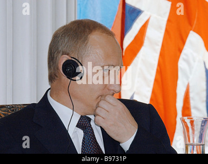 Russian President Vladimir Putin on an official visit to the United Kingdom met with Scottish scientists public - Stock Photo