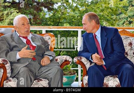 Russian President Vladimir Putin met with poet Rasul Gamzatov and wished him a happy 80th birthday Sochi - Stock Photo