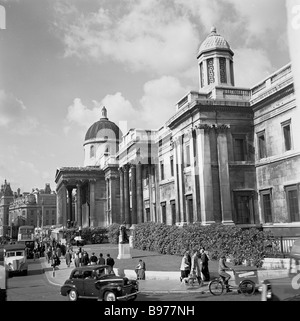 Cars and people in front of the columned entrance to The National Gallery at Trafalgar Square, London, England as - Stock Photo