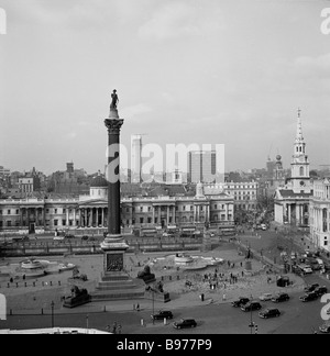 Ariel view of the tall monument, Nelson's Column, in Trafalgar Square, London 1950s by J Allan Cash. The National - Stock Photo