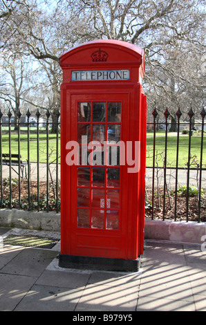 A red telephone box in Brunswick Square, London.  March 2009 - Stock Photo