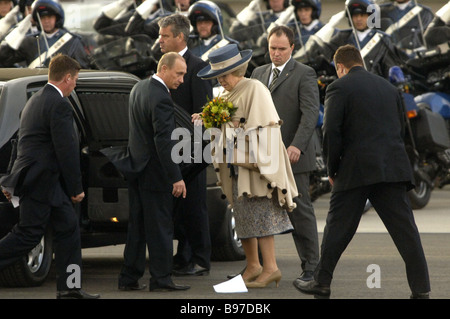 Queen Beatrix of the Netherlands and President Putin of Russia following the welcome at the Skiphol airport Amsterdam - Stock Photo