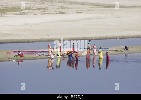 Women Washing Clothes in River Agra India TV000079 - Stock Photo