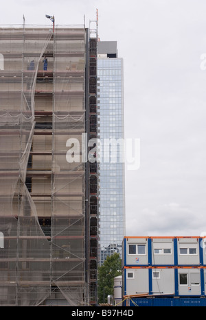 new constructions covered with protective mesh near Alexanderplatz Berlin Germany - Stock Photo