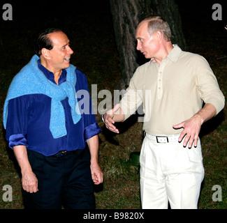 Russian President Vladimir Putin met with Italian Prime Minister Silvio Berlusconi in Bocharov Ruchei residence - Stock Photo