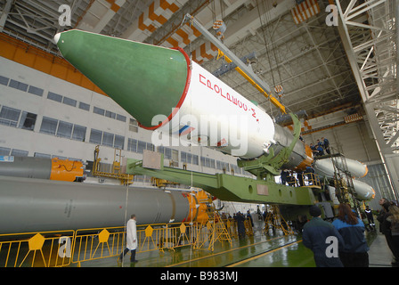 The orbiter processing facility of area 112 at the Baikonur Cosmodrome where the Soyuz U rocket is being assembled - Stock Photo