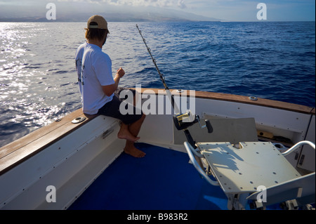 Big game fishing preparing bonito lure on fishing boat Saint Gilles La Réunion France | Hochseeangler präpariert - Stock Photo