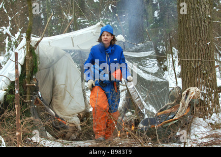 U S astronaut Catherine Coleman during a survival training for an unplanned landing of a descent module in the forest - Stock Photo