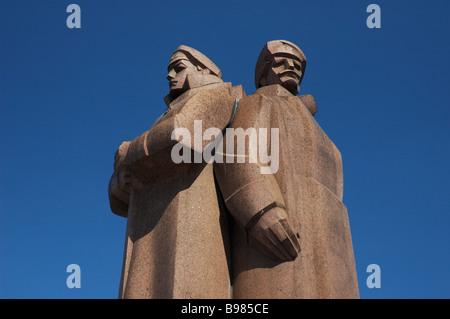 Latvian Red Rifleman statue Commemorates WW1 and Soviet conflict RIGA LATVIA - Stock Photo