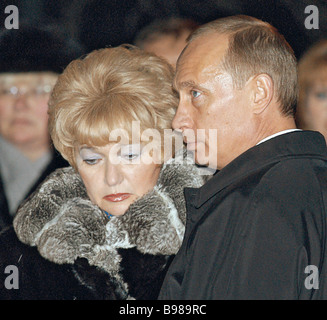 Russian President Vladimir Putin on his visit to St Petersburg He visited the Nikolskoye cemetery at the Alexander - Stock Photo