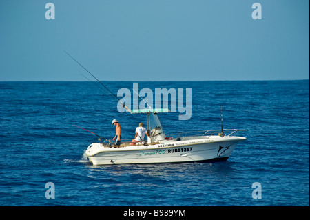 Big game fishing fishermen on fishing boat, Saint Gilles, La Réunion, France | Angler auf Fischerboot, Hochsee, - Stock Photo
