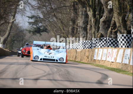 Goodwood Festival of Speed, Chichester West Sussex, cars make their way to the start line. - Stock Photo