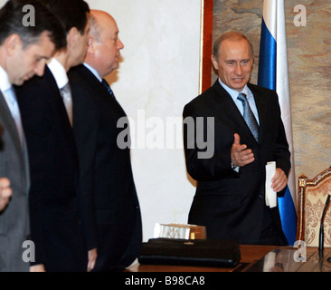 Russian President Vladimir Putin Prime Minister Mikhail Fradkov Vice Premier Alexander Zhukov and Health and Social - Stock Photo