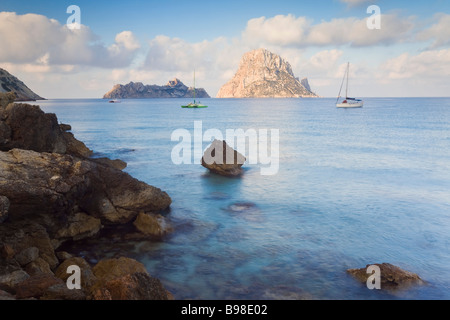 View of the rocky islet of Es Vedra from Cala d Hort near Sant Antoni Ibiza Balearic Islands Spain Mediterranean - Stock Photo