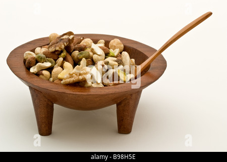 Fiji Kava bowl filled with nuts, with a wooden spoon - Stock Photo