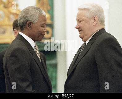 South African President Nelson Mandela left and Russian President Boris Yeltsin right meet each other in the Kremlin - Stock Photo