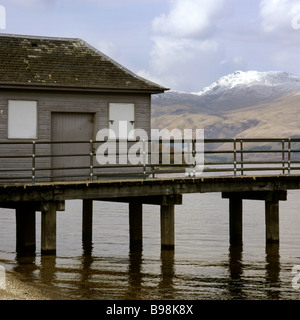 A view of snow topped Ben Lomond across Loch Lomond from Luss Pier Scotland - Stock Photo