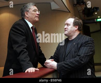 Russian Pension Fund chairman Gennady Batanov left and Duma deputy Ivan Zhdakaev at the Duma session - Stock Photo