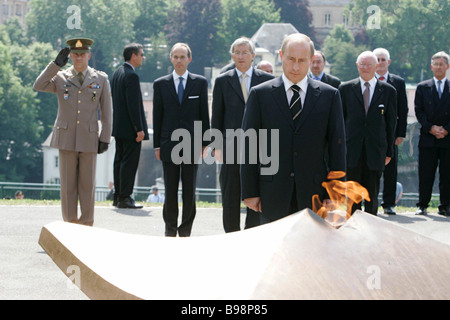 President Vladimir Putin foreground laid a wreath to the Eternal Fire in Luxembourg - Stock Photo