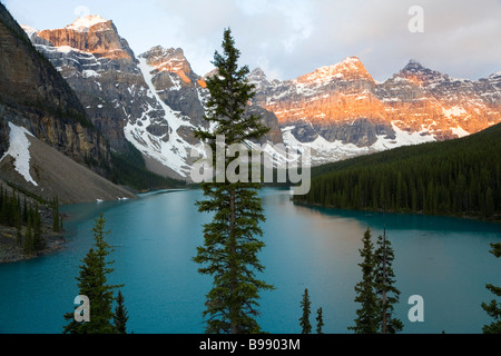 Moraine Lake at sunrise, Banff National Park, Alberta, Canada - Stock Photo