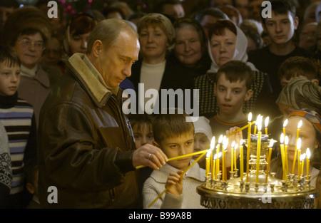 Russian President Vladimir Putin at the Nativity service in the Church of the Nativity of the Blessed Virgin Gorodnya - Stock Photo