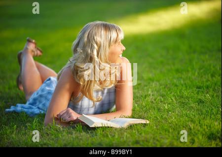 Girl lying in park - Stock Photo