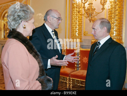 Prince Dmitry Romanov his wife and Russian President Vladimir Putin right at a ceremonial reception to mark National - Stock Photo