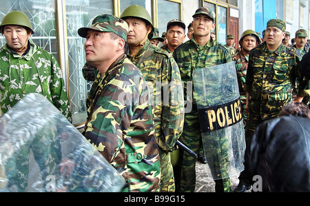 Riot police at the ready as opposition protest action goes on in Ala Too the central square of Bishkek Kyrgyz capital - Stock Photo