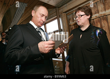 Russian President Vladimir Putin and Director of the Tsiolkovsky Home Museum Yelena Timoshenkova the great granddaughter - Stock Photo