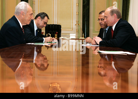 Shimon Peres Deputy Prime Minister of Israel left foreground and Russia s President Vladimir Putin right foreground - Stock Photo