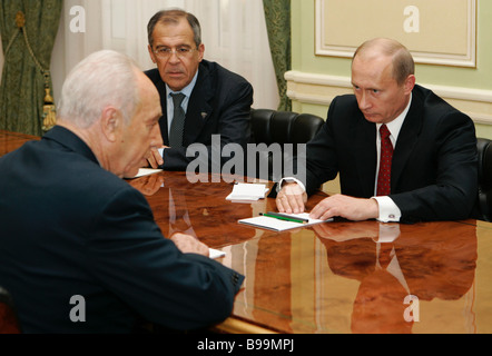 Left to right Shimon Peres Deputy Prime Minister of Israel and Russia s President Vladimir Putin and Foreign Minister - Stock Photo