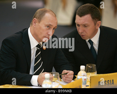Russian President Vladimir Putin and Oleg Deripaska Board Chairman of aluminium giant OAO RUSAL left to right attend - Stock Photo