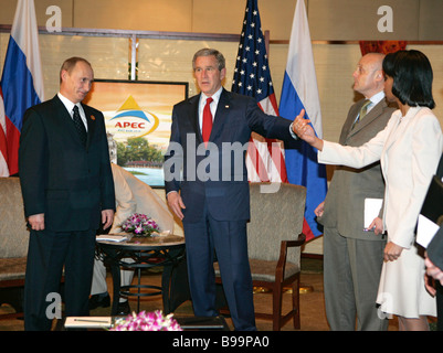 Russian President Vladimir Putin the United States President George Bush and State Secretary Condoleezza Rice left - Stock Photo