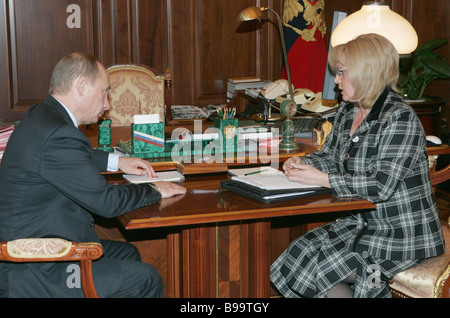 Russian President Vladimir Putin and Ella Pamfilova Presidential Council Chair for civil society institutions and - Stock Photo
