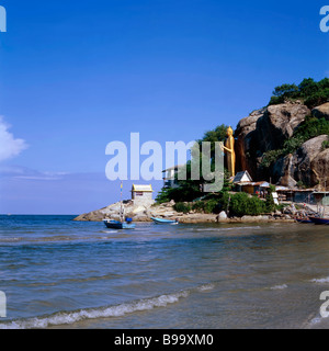 Golden Buddha statue overlooking the ocean at Khao Takiab beach, Hua Hin, Thailand, S. E. Asia. - Stock Photo