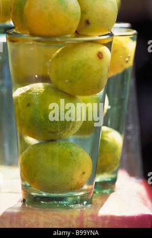 Lemons soaking in glass of water