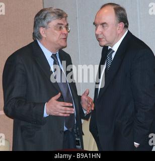 Head of the Russian Pension Fund Gennady Batanov and Deputy Health and Social Development Minister Vladimir Starodubov - Stock Photo