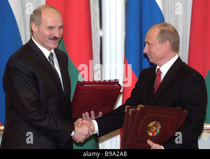 Russian president Vladimir Putin and Belarussian president Alexander Lukashenko right to left at the ceremony of - Stock Photo