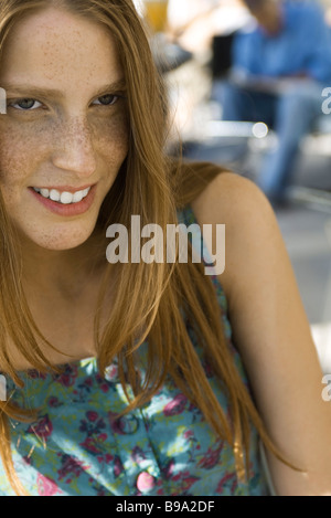 Young woman wearing tank top, portrait - Stock Photo