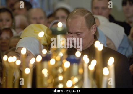 Russian President Vladimir Putin attending a Christmas service in the Church of the Nativity of Christ at the Voskresensky - Stock Photo